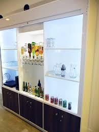 spray painting kitchen cupboards auckland bar cabinet walnut doors steel roller shutter door