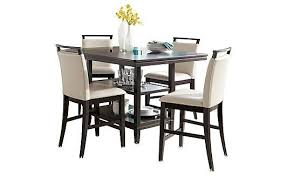 The Charrell Round Dining Room Table From Ashley Furniture - Branchville white round dining room furniture