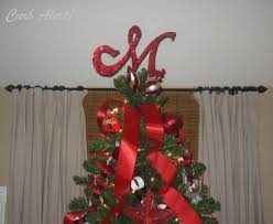 monogram tree topper curb alert glittery monogram tree topper