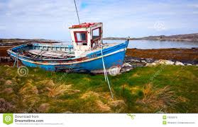 old fishing boat on the bank of ocean bay royalty free stock
