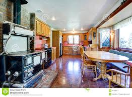 impressive farmhouse kitchen room with antique stove royalty free