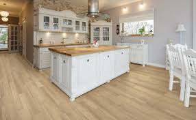 white kitchen cabinets with vinyl plank flooring luxury vinyl flooring carpet one floor home in