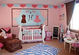 pink wall paint decoratingin nursery room with white baby box also