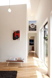 25 best floors images on pinterest flooring ideas wood look big and small house by anonymous architects light shining up