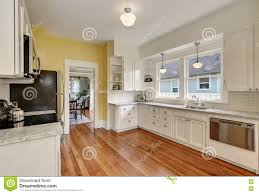 Yellow Kitchen White Cabinets Kitchen Interior With White Cabinets Yellow Walls And Wood Floor