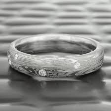 unique women s wedding bands women s damascus steel with scattered diamonds wedding band with