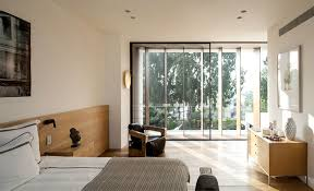floor to ceiling glass doors cozy looking and futuristically shaped mediterranean villa