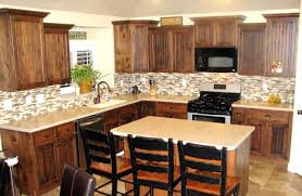 kitchen backsplash tile with dark cabinets glass countertop wooden