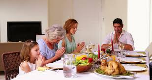 Turkey On The Table Family Of Three Generations Gathered For Festive Meal Grandmother