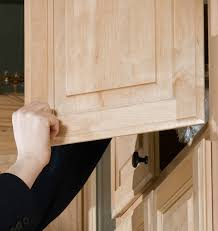 how to keep cabinet doors closed keeping cabinet doors from slamming shut thriftyfun