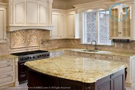 venetian gold light granite the grand island is the focal point of this bright and airy kitchen