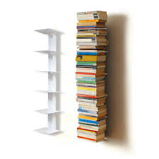 spine wall white bookshelves