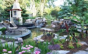 backyard retreat with paver patio koi pond waterfalls spa and