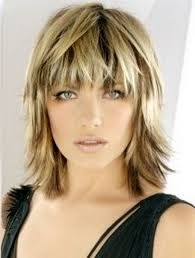 blonde medium length choppy shag haircut with wispy bangs and dark