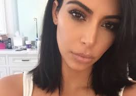 does kim kardashian really not smile because of body shaming verily