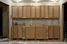 how to fix kitchen base cabinets to wall wall of cabinets installed plus how to install