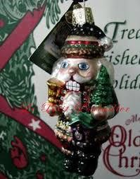 merck familys world ornaments santas scraps cromos