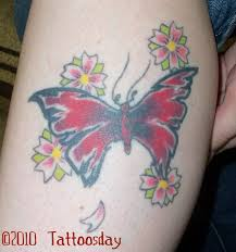 butterfly and hawaiian flower tattoos overexposed notes on a
