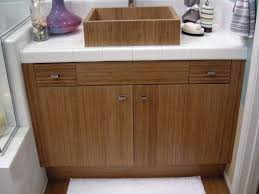scotch bamboo bathroom cabinets with bamboo vessel sink and white