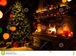 atmospheric christmas card with tree presents and fireplace stock