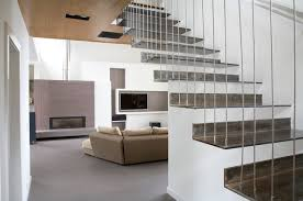 Living Room With Stairs Design Hanging Stair Houzz