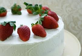 fresh strawberry cake with cream cheese swiss meringue buttercream