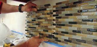 installing tile backsplash in kitchen how to install a mosaic tile backsplash today s homeowner