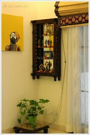 a section of the dining room has been dedicated as the pooja