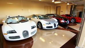 bugatti gold and white floyd mayweather has bought over 100 luxury cars from the same