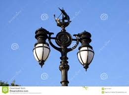 Outdoor Electric Post Lights by Vintage Street Lamp Post With Ship Sculpture In London England