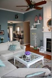 painted blue accent wall in a living room looking ahead room