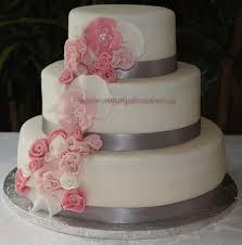 wedding cake fondant 3 tier fondant wedding cake with spray of pink fondant flowers