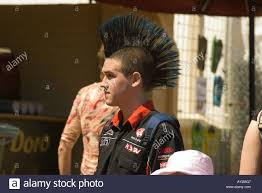 boy with punk hairstyle in street stock photo royalty free image