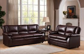 adorable chocolate leather room to go sofas creamy wall paint
