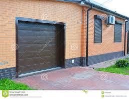 Security Garage Door by House Garage Door With Ventilation Air Conditioner Rain Gutter