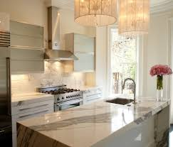 calacatta marble kitchen transitional with floral arrangement
