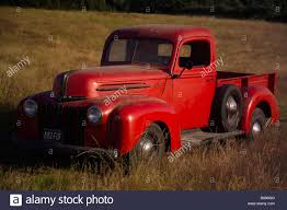 Ford Vintage Truck - front view of an old american red ford pick up truck stock photo