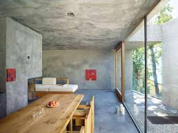 Concrete Interior Design by Tiny Concrete Bunker Opens To Reveal A 3 Story Home