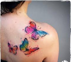three watercolor flying butterflies tattoos on back shoulder