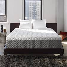 bedroom grey carpet and comforpedic with white wall design and