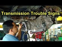 transmission trouble signs checking fluid level color smell