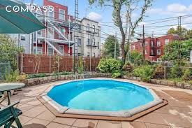 greenpoint townhouse with rare backyard pool seeks 3 1m curbed ny