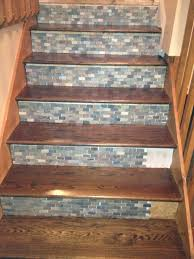 Remodeling Basement Stairs by Stone Backsplash Tile Used On Stair Risers Home Inprovement