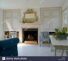 pale blue painted chairs on either side of fireplace in living