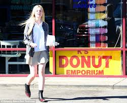 elle fanning goes back down to earth in boots after prada