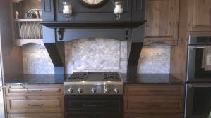 silver travertine backsplash with inlay bluegrass flooring