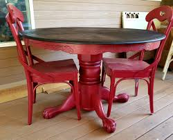 red painted and glazed clawfoot round pedestal oak dining table