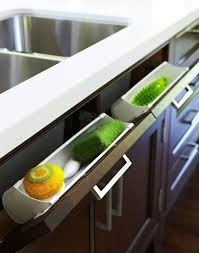 clever kitchen storage ideas use pull out panel below kitchen sink to store sponges and