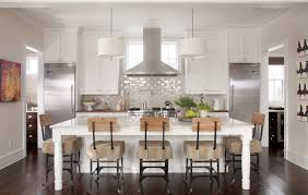 Neutral Kitchen Ideas - neutral kitchen with red accents black ceramic floor tile white