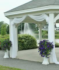 use fabric tulle to decorate gazebo maybe just at the entrance